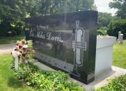 """The grave of jazz great Miles Davis appears at Woodlawn Cemetery in the Bronx borough of New York on June 27, 2021. The corner is a stop on a trolley tour of """"jazz and vaudeville greats"""" offered by the cemetery. (AP Photo/Julia Rubin)"""