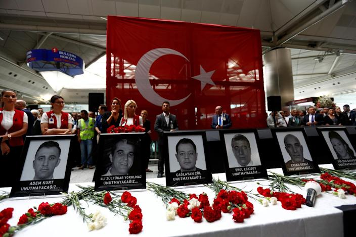 <p>Airport employees attend a ceremony for their friends, who were killed in Tuesday's attack at the airport, at the international departure terminal of Ataturk airport in Istanbul, Turkey, June 30, 2016. (REUTERS/Murad Sezer) </p>