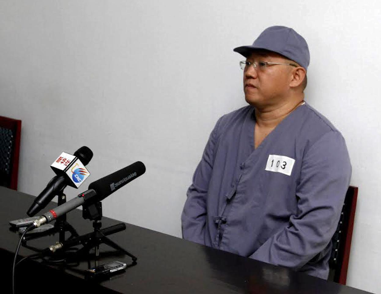 American missionary Kenneth Bae speaks to reporters at Pyongyang Friendship Hospital in Pyongyang Monday, Jan. 20, 2014. Bae, 45, who has been jailed in North Korea for more than a year, appealed for the U.S. to do its best to secure his release. (AP Photo/Kim Kwang Hyon)