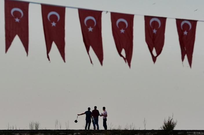 Since the July 15 coup attempt in Turkey, reporters have been arrested or suspended, accused of conspiring against President Erdogan (AFP Photo/Aris Messinis)