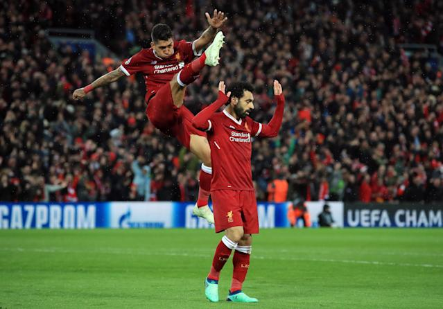 "Liverpool's Mohamed Salah and Roberto Firmino celebrate Salah's second goal of the Champions League semifinal first leg against <a class=""link rapid-noclick-resp"" href=""/soccer/teams/roma/"" data-ylk=""slk:Roma"">Roma</a>. (Getty)"