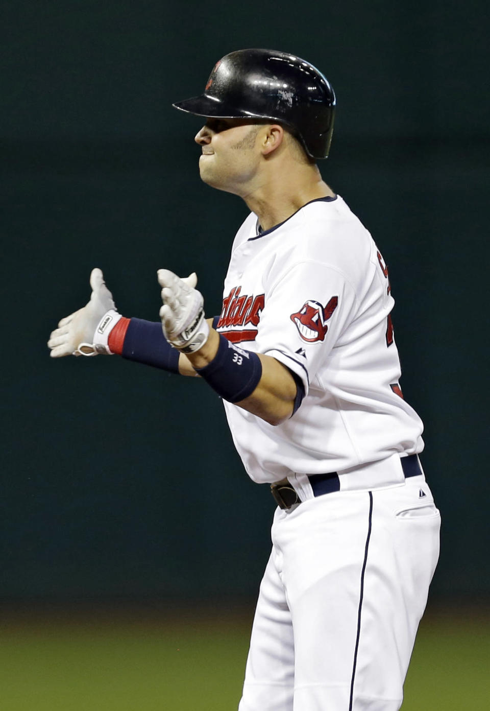 Cleveland Indians' Nick Swisher celebrates at second base after an RBI double in the seventh inning of a baseball game against the Detroit Tigers on Wednesday, Aug. 7, 2013, in Cleveland. (AP Photo/Mark Duncan)