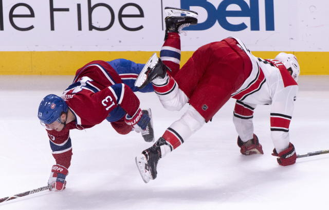 Montreal Canadiens' Max Domi, left, and Carolina Hurricanes' Jordan Staal collide during the first period of an NHL hockey game Tuesday, Nov. 27, 2018, in Montreal. (Paul Chiasson/The Canadian Press via AP)