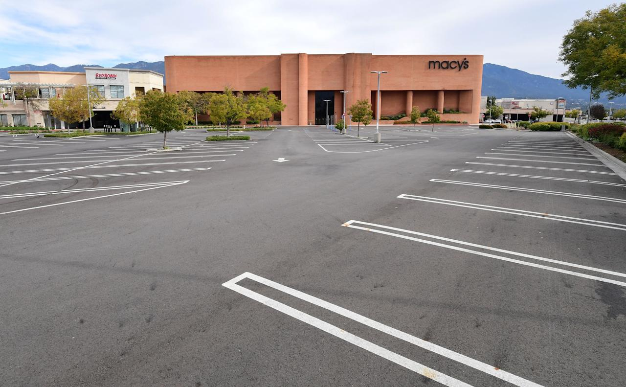 An empty parking lot in front of Macy's is seen at the Westfield Santa Anita shopping mall in Arcadia, Caifornia on March 18, 2020 as major retail stores close nationawide due to the coronavirus epidemic gripping fear across the United States. (Photo by Frederic J. BROWN / AFP) (Photo by FREDERIC J. BROWN/AFP via Getty Images)