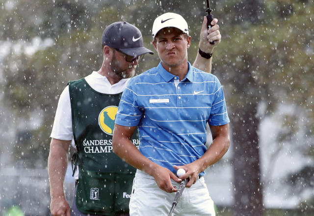 Defending champion Cameron Champ looks around the ninth green as a weather warning is sounded during the opening round of the Sanderson Farms Championship golf tournament in Jackson, Miss., Thursday, Sept. 19, 2019. Play was stopped. (AP Photo/Rogelio V. Solis)