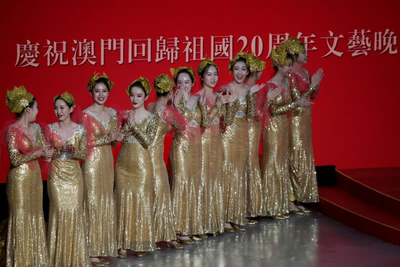 Performers are seen on the stage during a cultural performance in Macau