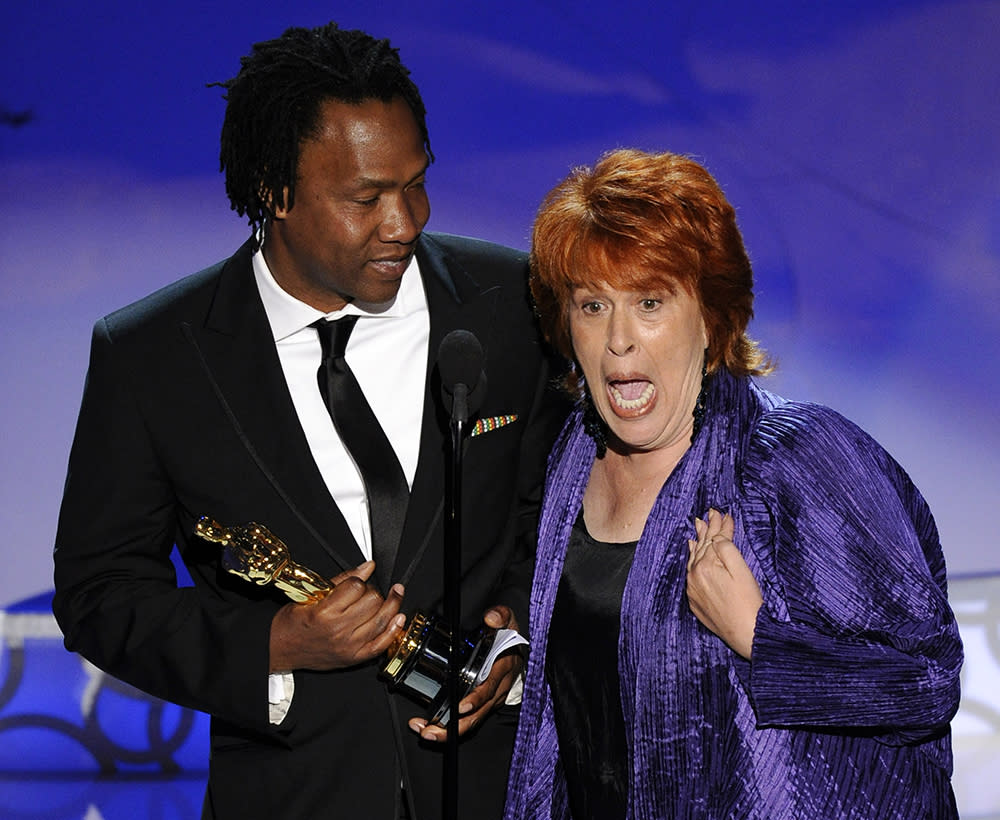 "While it wasn't a Kanye West-Taylor Swift-style speech interruption at the 2010 Oscars ceremony, the night's awkward speech moment turned out to have an equally entertaining backstory. When director Roger Ross Williams was accepting the award for Best Documentary Short for ""Music by Prudence,"" he didn't make it far before a woman joined him at the microphone, taking over the speech as Williams stood by awkwardly. The co-speech giver was Elinor Burkett, producer on the film and fellow Oscar winner who had a creative falling out with Williams, which prevented the two from discussing how exactly they'd accept the award if their film won. What was Burkett's explanation for being late to the stage? ""His mother took her cane and blocked me. So I couldn't get up there very fast."""