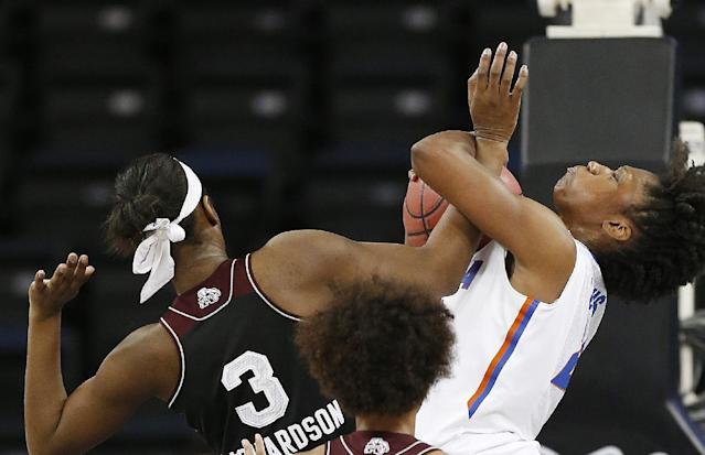 Florida guard Kayla Lewis, right, and Mississippi State forward Breanna Richardson (3) fight for a rebound in the first half of a second-round women's Southeastern Conference tournament NCAA college basketball game Thursday, March 6, 2014, in Duluth, Ga. (AP Photo/John Bazemore)