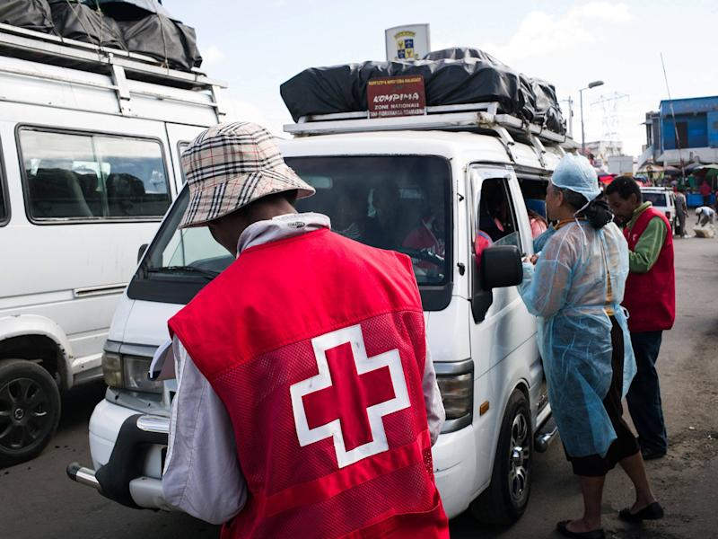Red Cross workers in Antananarivo, Madagascar, where the plague has spread: AFP/Getty