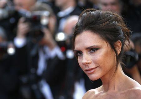 """Fashion designer, model and singer Victoria Beckham poses on the red carpet as she arrives for the opening ceremony and the screening of the film """"Cafe Society"""" out of competition during the 69th Cannes Film Festival in Cannes, France, May 11, 2016. REUTERS/Yves Herman"""