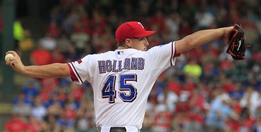 Texas Rangers starting pitcher Derek Holland (45) throws during the first inning of a baseball game against the Toronto Blue Jays Friday, May 25, 2012, in Arlington, Texas. (AP Photo/LM Otero)