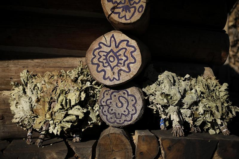 Dried herbs sit in the sun outside a steam sauna at the British Banya bathhouse, Saturday, Feb. 15, 2014, in Krasnaya Polyana, Russia, just a few miles away from the ski slopes where athletes are competing for Olympic medals. (AP Photo/Jae C. Hong)