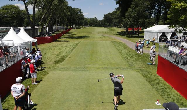 Ted Potter Jr., drives from the first tee during Pro-Am at the Rocket Mortgage Classic golf tournament, Wednesday, June 26, 2019, in Detroit. (AP Photo/Carlos Osorio)