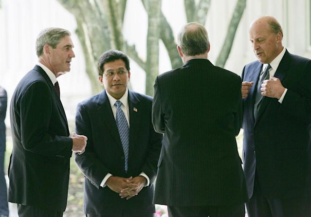 <p>From left to right, Federal Bureau of Investing Director Robert Mueller, U.S. Attorney General Alberto Gonzales, National Security Adviser Stephen Hadley and Director of National Intelligence John Negroponte talk outside the entrance to the CIA Headquarters after attending the ceremonial swearing-in for the new Director of the CIA, Gen. Michael Hayden, Wednesday, May 31, 2006 in Langley, Va. (Photo: Pablo Martinez Monsivais/AP) </p>