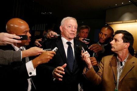 FILE PHOTO: Dallas Cowboys owner Jerry Jones speaks to members of the media as he exits the NFL owners meeting in New York City, U.S. October 17, 2017. REUTERS/Brendan McDermid