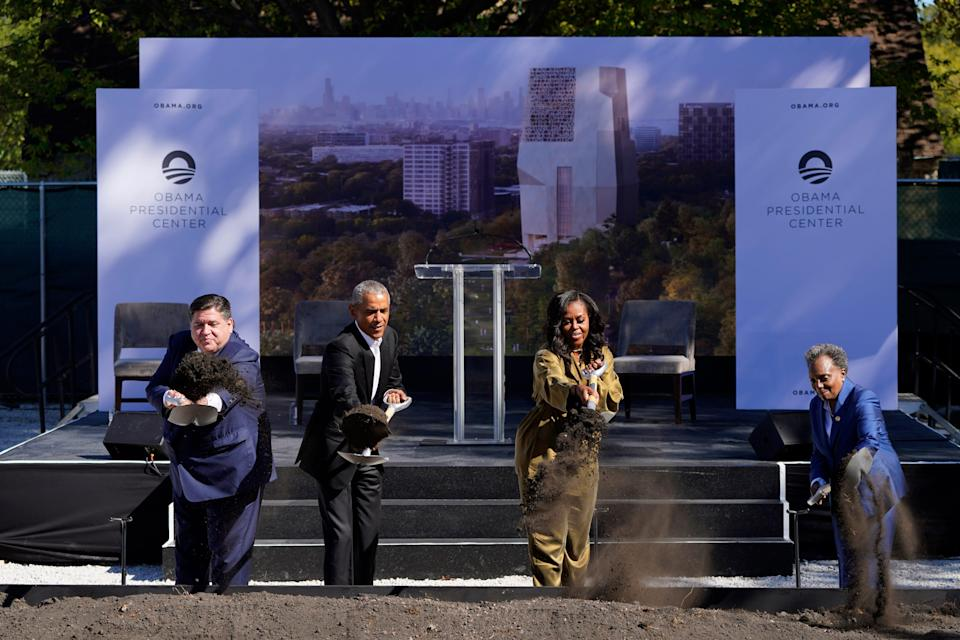 Former President Barack Obama, second from left, is joined by Illinois Gov. J.B. Pritzker, left, former first lady Michelle Obama, and Chicago Mayor Lori Lightfoot during a groundbreaking ceremony for the Obama Presidential Center Tuesday, Sept. 28, 2021, in Chicago.