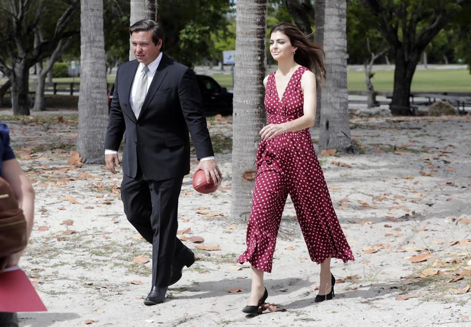 DeSantis walks with his wife Casey following a news conference, April 22, 2019, in Key Biscayne, Fla.