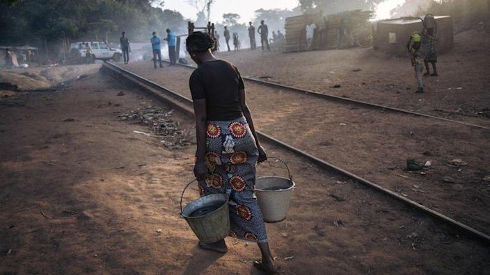 A refugee woman in Central Africa brought water to a refugee site in Nudu, Democratic Republic of the Congo, on January 21, 2021.