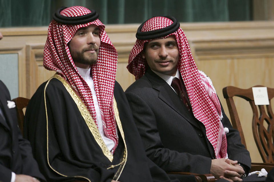 FILE - In this Nov. 28, 2006, file photo, Prince Hamzah Bin Al-Hussein, right, and Prince Hashem Bin Al-Hussein, left, half brothers of King Abdullah II of Jordan, attend the opening of the parliament in Amman, Jordan. Prince Hamzah said in a recording released Monday, April 5, 2021, that he will defy government threats ordering him to stay at home and refrain from public statements following accusations he was behind a plot to destabilize the kingdom. (AP Photo/Mohammad abu Ghosh, File)