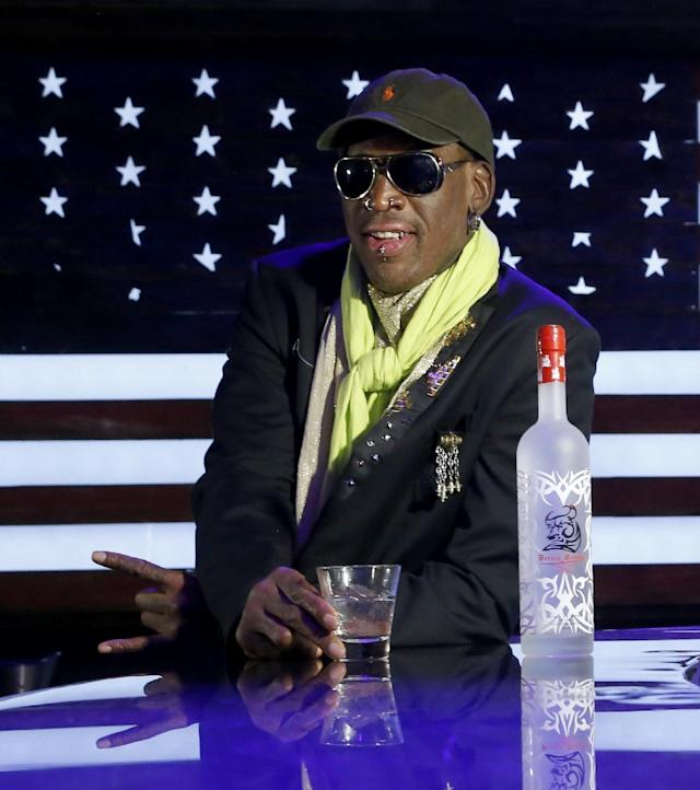 """In this Thursday, Nov. 21, 2013 photo, Dennis Rodman poses during a promotional event to pitch a vodka brand after a launch party in Chicago. Rodman looked fit and at ease, not squirming even once _ a childhood habit that earned the nickname """"The Worm."""" He said he wouldn't talk about his relationship with Kim or North Korean politics, including its horrific human-rights record and secretive nuclear weapons program.(AP Photo/Charles Rex Arbogast)"""