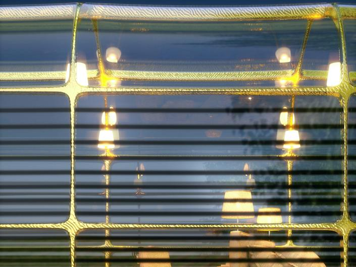 a rendering of the G Train's partially transparent golden window