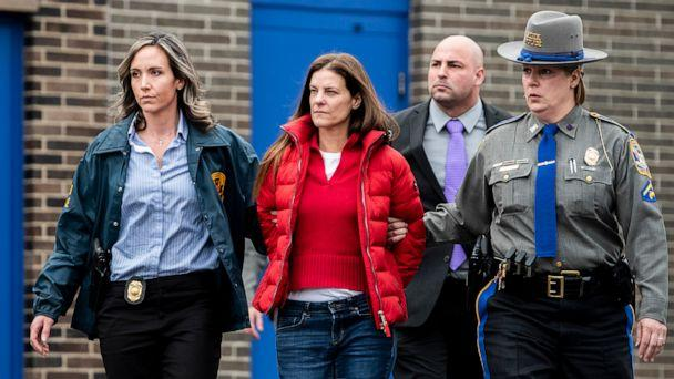 PHOTO: Michelle Troconis is escorted out of the Troop G State Police station before being placed into a cruiser, Jan. 7, 2020. (Kassi Jackson/TNS via Newscom)