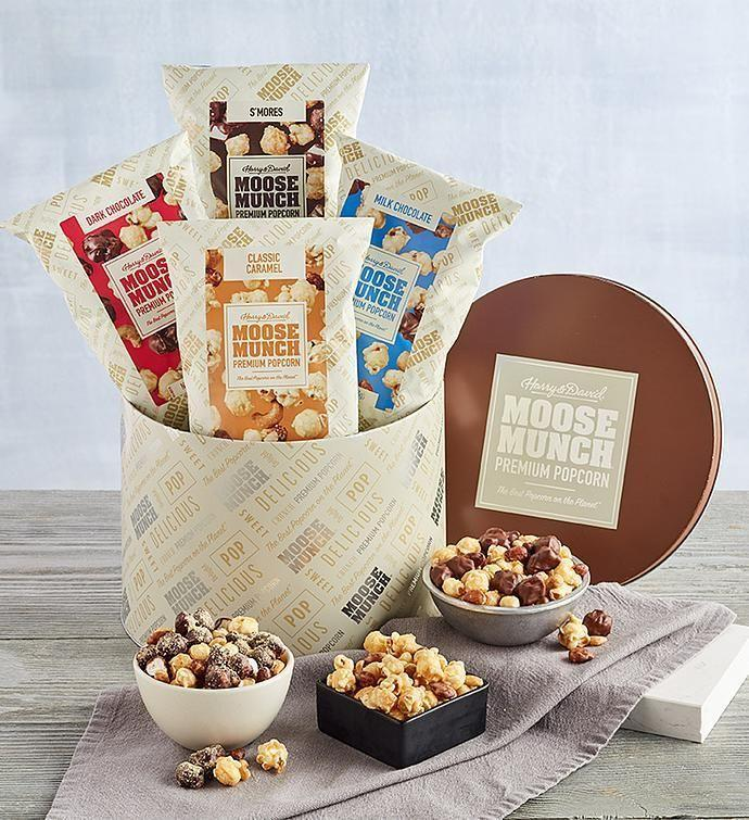 """<p><strong>Moose Munch</strong></p><p>harryanddavid.com</p><p><strong>$49.99</strong></p><p><a href=""""https://go.redirectingat.com?id=74968X1596630&url=https%3A%2F%2Fwww.harryanddavid.com%2Fh%2Fchocolates-sweets-candy%2Fmoose-munch-gourmet-popcorn%2F13820&sref=https%3A%2F%2Fwww.womansday.com%2Flife%2Fg24378973%2Fbest-gifts-for-boss%2F"""" rel=""""nofollow noopener"""" target=""""_blank"""" data-ylk=""""slk:Shop Now"""" class=""""link rapid-noclick-resp"""">Shop Now</a></p><p>You can't beat the combination of salty and sweet, and this popcorn gift tin — which includes four varieties of Moose Munch popcorn — is sure to earn you Employee of the Month. </p>"""