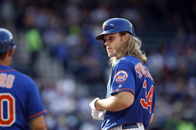 New York Mets' pitcher Noah Syndergaard is firmly against a universal designated hitter rule taking away his at-bats. (AP)