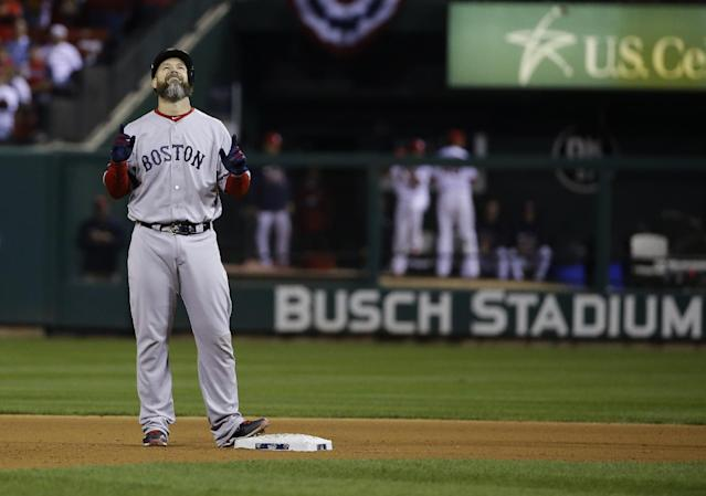 Boston Red Sox catcher David Ross reacts after hitting an RBI ground rule double to left field against the St. Louis Cardinals during the seventh inning of Game 5 of baseball's World Series Monday, Oct. 28, 2013, in St. Louis. (AP Photo/Matt Slocum)