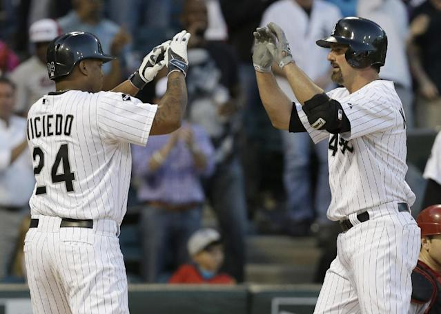 Chicago White Sox's Paul Konerko, right, celebrates with teammate Dayan Viciedo after hitting a two-run home run against the Arizona Diamondbacks during the fifth inning of an interleague baseball game in Chicago, Saturday, May 10, 2014. (AP Photo/Nam Y. Huh)