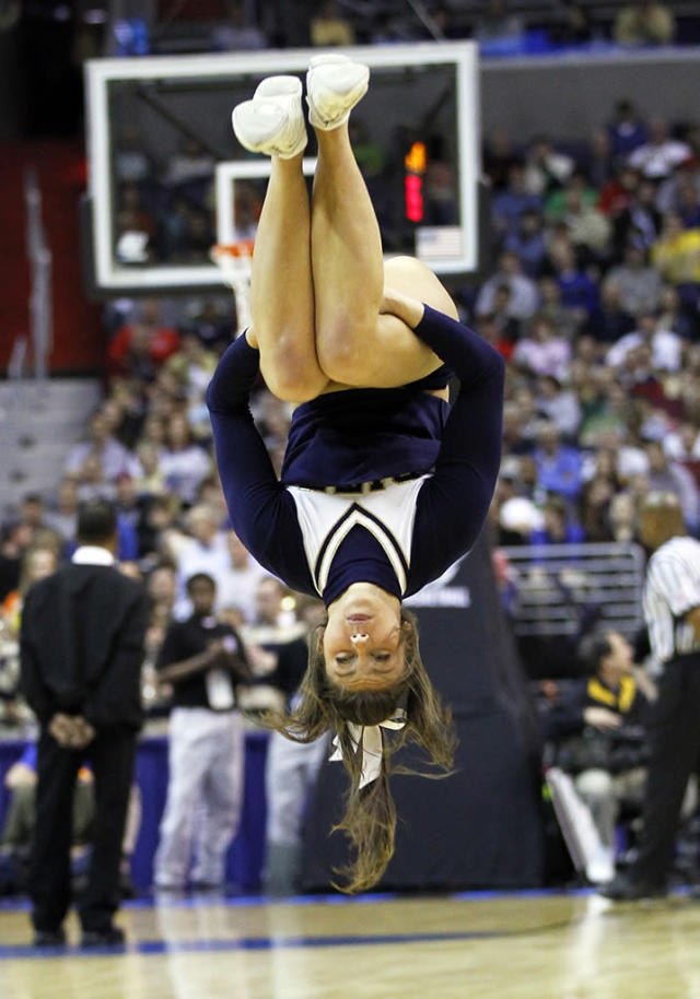 A Butler cheerleader performs a back flip during a time out in the first half against Pittsburgh in the third round of the 2011 NCAA Men's Basketball Championship tournament at the Verizon Center in Washington, D.C., Saturday, March 19, 2011. Butler defeated Pitt, 71-70. (Harry E. Walker/MCT via Getty Images)