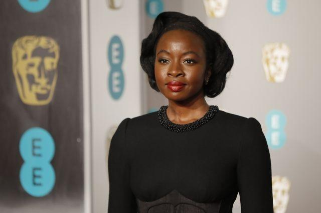 Old-school Hollywood glamour for Danai Gurira with red lips and a structured updo