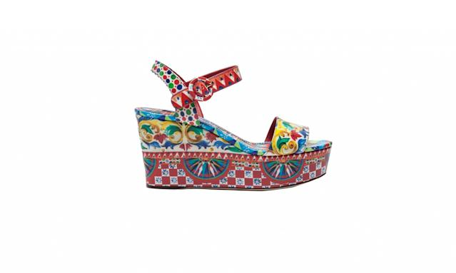 "<p>Patent leather wedge sandals, $945, <a href=""http://us.dolcegabbana.com/en/women/shoes/patent-leather-wedge-sandals-mambo-print-CZ0105AG147HW672.html"" rel=""nofollow noopener"" target=""_blank"" data-ylk=""slk:dolcegabbana.com"" class=""link rapid-noclick-resp"">dolcegabbana.com</a> </p>"