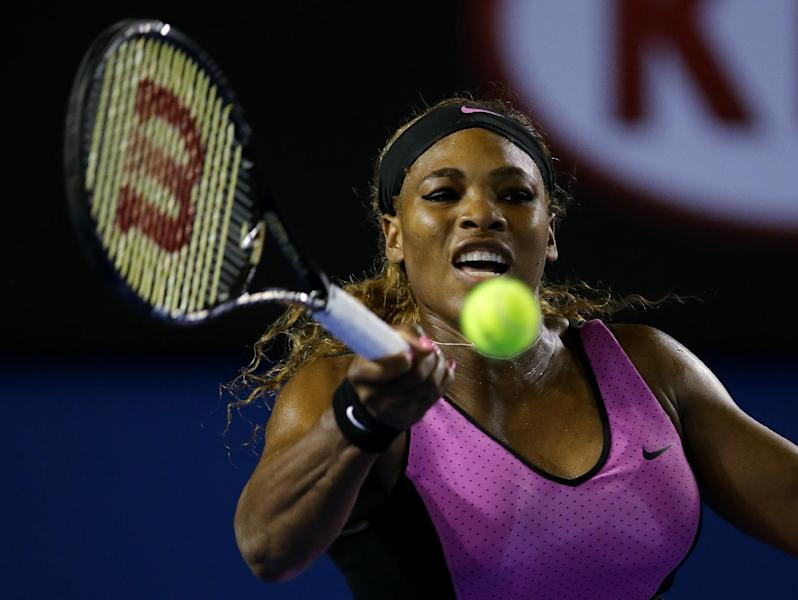 Serena Williams of the United States hits a forehand return to Ashleigh Barty of Australia during their first round match at the Australian Open tennis championship in Melbourne, Australia, Monday, Jan. 13, 2014.(AP Photo/Aaron Favila)
