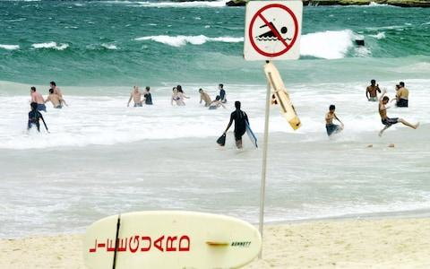 A proposal to ban surfing on most of Australia's iconic Bondi Beach has triggered anger among the local boarding community - Credit: RICK RYCROFT/AP