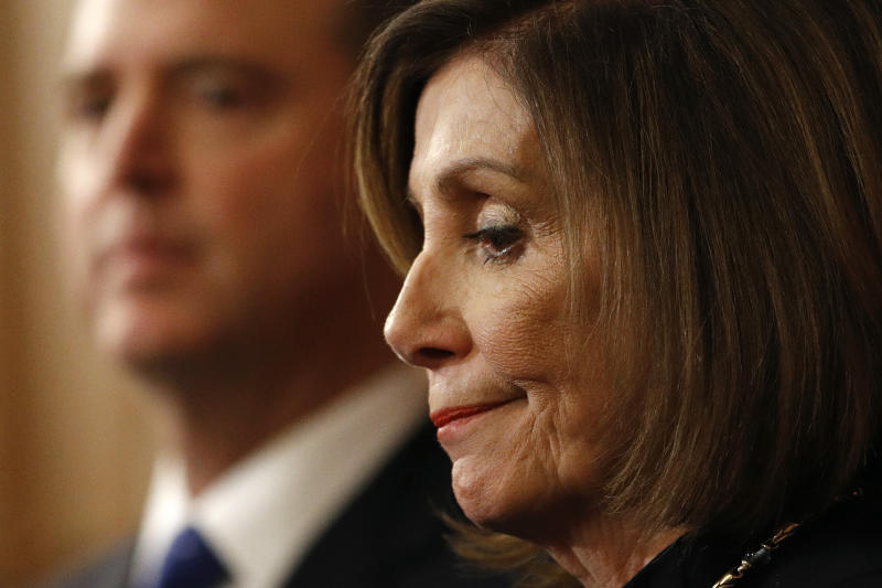 House Speaker Nancy Pelosi of Calif., stands alongside House Intelligence Committee Chairman Rep. Adam Schiff, D-Calif., on Capitol Hill in Washington, Wednesday, Dec. 18, 2019, after the U.S. House voted to impeach President Donald Trump on two charges, abuse of power and obstructing Congress. (AP Photo/Patrick Semansky)
