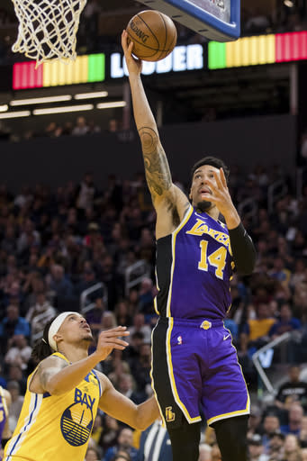 FILE - Los Angeles Lakers guard Danny Green (14) shoots as Golden State Warriors guard Damion Lee (1) defends in the first half of an NBA basketball game in San Francisco, in this Saturday, Feb. 8, 2020, file photo. Teams may begin making trades Monday, according to a memo sent to teams and obtained early Sunday, Nov. 15, 2020, by The Associated Press. And the first deal known to be tentatively agreed upon would send guard Dennis Schrder from Oklahoma City to the champion Los Angeles Lakers for Danny Green and the No. 28 pick in Wednesdays draft, a person with knowledge of that agreement told the AP. (AP Photo/John Hefti, File)
