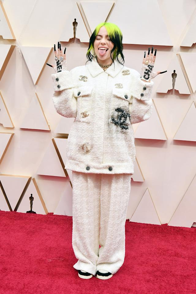 """<p>Grammy-winning singer <a href=""""https://www.popsugar.com/beauty/billie-eilish-hair-accessory-oscars-2020-47195814"""" class=""""ga-track"""" data-ga-category=""""Related"""" data-ga-label=""""https://www.popsugar.com/beauty/billie-eilish-hair-accessory-oscars-2020-47195814"""" data-ga-action=""""In-Line Links"""">Billie Eilish arrived at the 2020 Oscars with not one, but two, eye-catching beauty trends</a>. The star debuted mile-high  black diamond-studded stiletto nails and a Chanel hair accessory that wound through her loose bun.</p>"""