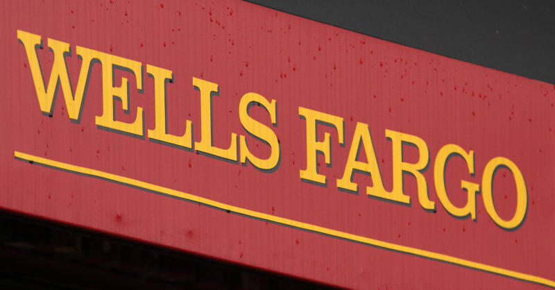 FILE - This Jan. 12, 2012 file photo shows the logo at a Wells Fargo Home Mortgage center in Pittsburgh. Wells Fargo, a San Francisco-based bank, reported a 13 percent rise in income in the first three months of the year on an increase in mortgage lending. (AP Photo/Gene J. Puskar, File)