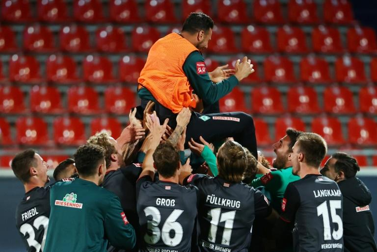 Claudio Pizarro, 41, is cheered by his Werder Bremen team-mates as he retired after their relegation/promotion play-off on Monday at Heidenheim