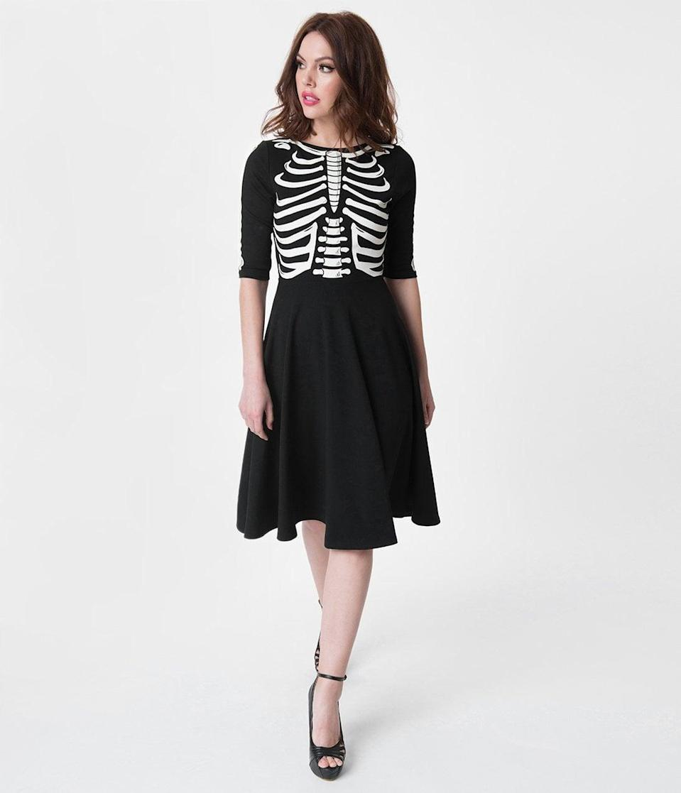 <p>The spine-chilling <span>Unique Vintage Black Skeleton Bones Graves Swing Dress</span> ($98) will not disappoint. </p>
