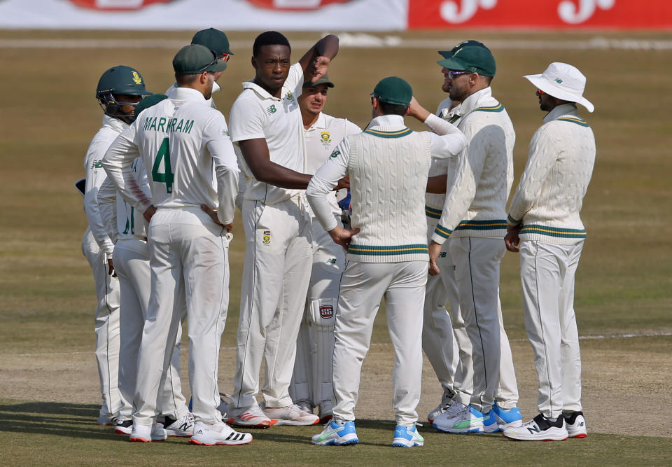 South Africa's Kagiso Rabada, center, celebrates with teammates after taking the wicket of Pakistan's Imran Butt during the third day of the second cricket test match between Pakistan and South Africa at the Pindi Stadium in Rawalpindi, Pakistan, Saturday, Feb. 6, 2021. (AP Photo/Anjum Naveed)