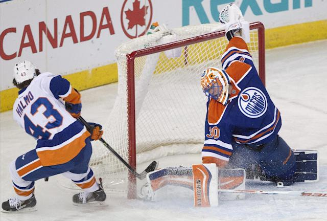 New York Islanders' Mike Halmo (43) is stopped by Edmonton Oilers goalie Ben Scrivens (30) during the second period of an NHL hockey game in Edmonton, Alberta, on Thursday, March 6, 2014. (AP Photo/The Canadian Press, Jason Franson)