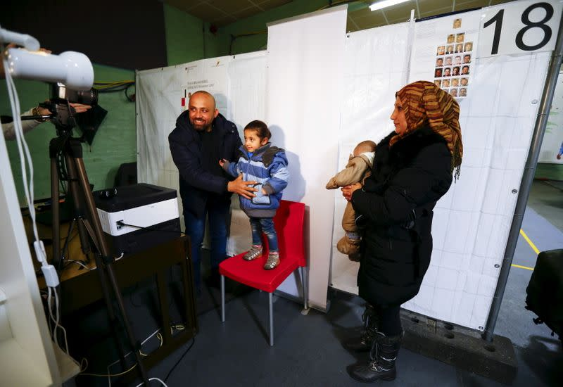 FILE PHOTO: Syrian refugees are being registered for the newly issued German Ankunftsnachweis in Herford