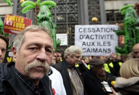 French environmentalist Jose Bove attends a demonstration as part of the World Climate Change Conference 2015  in Paris