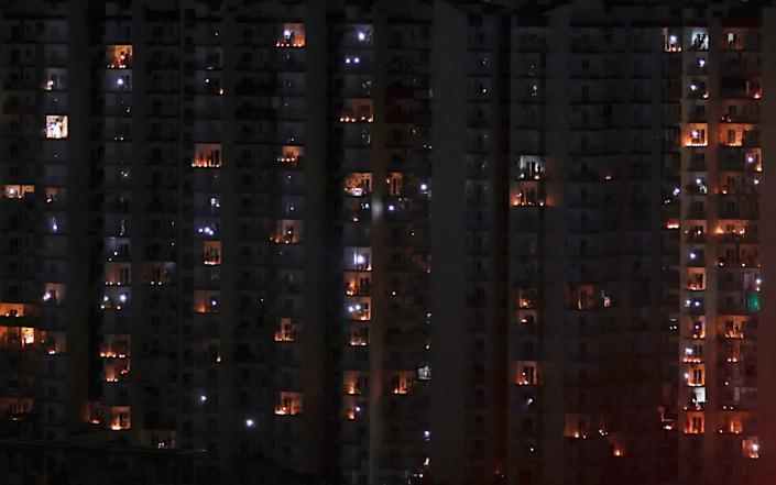 Balconies are illuminated with candles and torches to mark the country's fight against COVID-19 in Greater Noida, a suburb of New Delhi, India
