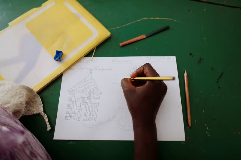 Woman who said she was raped twice, attends a drawing workshop at La Maison Rose in Dakar
