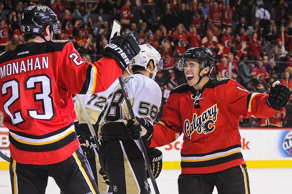 CALGARY, AB - NOVEMBER 7: Sean Monahan #23 (L) and Johnny Gaudreau #13 of the Calgary Flames celebrate after Monahan scored against the Pittsburgh Penguins during an NHL game at Scotiabank Saddledome on November 7, 2015 in Calgary, Alberta, Canada. (Photo by Derek Leung/Getty Images)