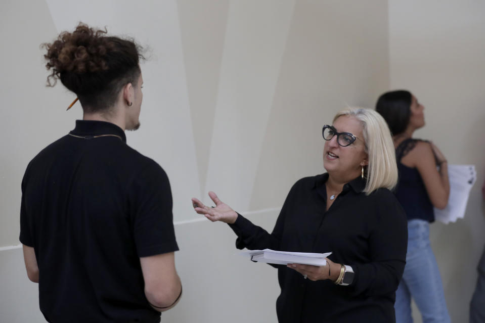 FILE - In this Oct. 1, 2019, file photo, Gory Rodriguez, of Starbucks, right, interviews a job applicant during a job fair at Dolphin Mall in Miami. On Friday, Nov. 1, the U.S. government issues the October jobs report. (AP Photo/Lynne Sladky, File)