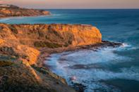 """<p><strong>Give us the wide-angle view: What kind of beach are we talking about?</strong><br> This starts with a coastal hike that leads to a secluded cove that's marked by stunning tide pools and rock formations. If you're looking for a sunbathing beach, this isn't it, but if you're after natural beauty, you've come to the right spot.</p> <p><strong>How accessible is it?</strong><br> Pay the $6 parking fee at Abalone Cove Shoreline Park (good for two hours, $12 for over two), then head toward the water following the Abalone Cove Trail along a cliff-side fence that takes you along your way to a stunning hike along the California coastline.</p> <p><strong>How's the actual beach stuff—sand and surf?</strong><br> The Rancho Palos Verdes water can be chilly, but the rugged coastline is worth the hike down for the views and serenity.</p> <p><strong>Can we go barefoot?</strong><br> Not if you care about your feet. This is a rocky shoreline with tide pools filled with starfish, sea anemones, and abalone shells. Use caution when navigating the rock pools—they can get slippery with algae. The views out to sea are spectacular though, and on a clear day you can see Catalina Island.</p> <p><strong>Anything special we should look for?</strong><br> This hike and beach are all about the views. You'll want to wear hiking shoes that you don't mind getting wet, as there's some scurrying along the rocks you'll need to do once you get to the main beach attraction: Sacred Cove. </p> <p><strong>If we're thinking about going, what—and who—is this beach best for?</strong><br> If you're a nature lover hoping to explore a portion of the iconic <a href=""""https://www.cntraveler.com/galleries/2014-08-21/a-sunset-hike-down-the-southern-california-coast?mbid=synd_yahoo_rss"""" rel=""""nofollow noopener"""" target=""""_blank"""" data-ylk=""""slk:California Coastal Trail"""" class=""""link rapid-noclick-resp"""">California Coastal Trail</a> (""""CCT,"""" as it's called by locals), this is a great way to get a taste.</p>"""